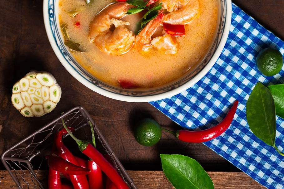 shrimp-soup-in-white-ceramic-bowl-with-chili-on-brown-wooden-1437590