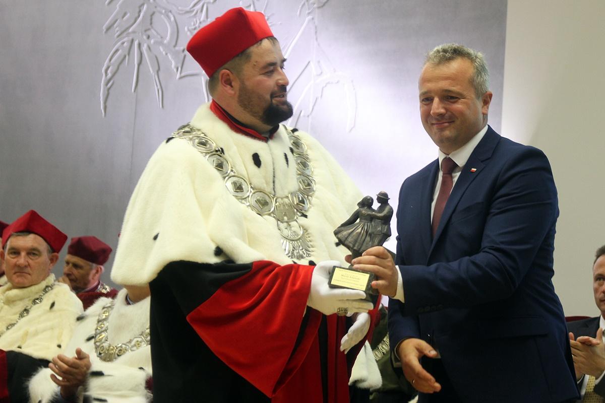 Mikołaj Bogdanowicz, Marek Adamski